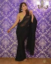Anasuya Bharadwaj in golden blouse transparent black saree mango shaped