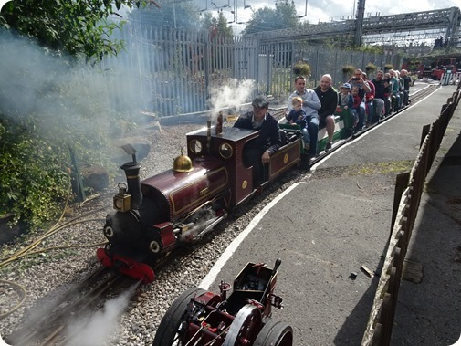 Visitors enjoy a ride on a miniature railway