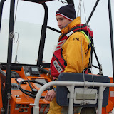 Crew Member Oli Mallinson at the helm on exercise on Sunday 20 January 2013 Photo: RNLI Poole/Dave Riley