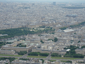 The Louvre in the middle of the photo, zoomed from the top of the Eiffel Tower