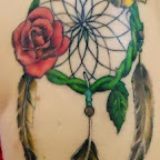 feathers roses leg - tattoos for women
