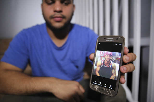 Christian Romero shows HuffPost a photo of his late brother Romsy on 14 October 2017. The family says doctors believe he died after being infected with leptospirosis. Photo: Carolina Moreno / HUFFPOST