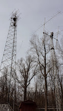 Photo: VHF, UHF microwave free standing tower (left), Terry W8ZN on 2m EME tower installing triband FM vertical pre-contest.