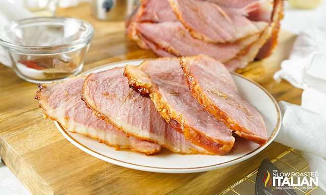 slices of maple glazed ham on a plate