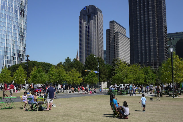 people relaxing on the grass at Klyde Warren Park