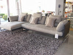 divano Saba Livingstone in tessuto e pelle con piedi in acciaio cromati .jpg