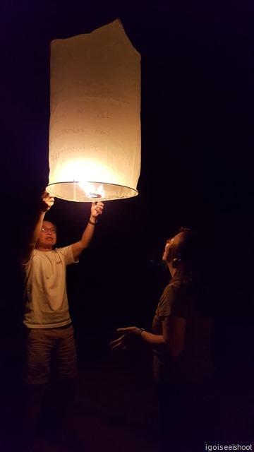 Preparing the sky lantern for launch.