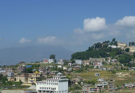 New gompa at Khachoe Ghakyil Nunnery with Kopan Monastery in background, Nepal. Photo courtesy of Kopan Monastery.