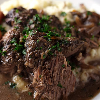 One Pot Red Wine Braised Beef Roast with Carrots, Onions, and Garlic.