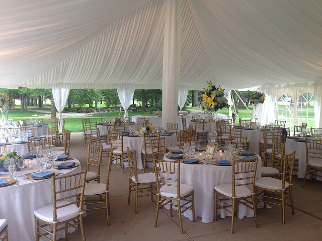 Yellow blue and white tented wedding