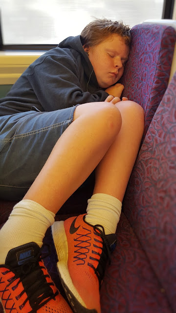 Asleep on the train seats