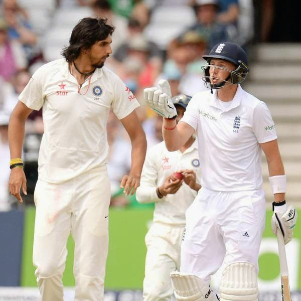 England's Joe Root (R) talks to India's Ishant Sharma during the first cricket test match at Trent Bridge cricket ground in Nottingham, England July 12, 2014.