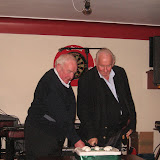 Martin McLoughlin and Patsy Gallagher cutting the cake.