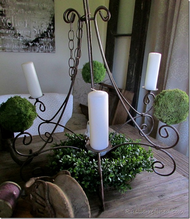 Rusty chandelier as a centerpiece for a rustic tablescape that celebrates Father's Day