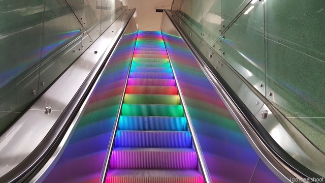 Escalators with colourful lights at Fridhelmsplan station.
