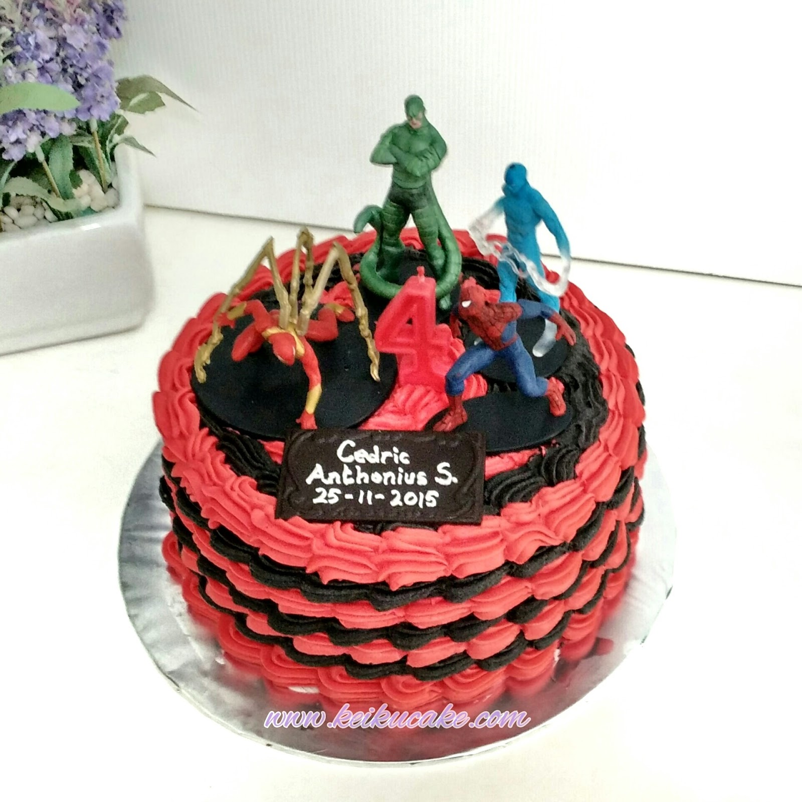 Black and red buttercream spiderman cake .