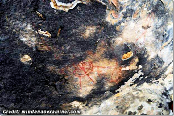 10,000 year old cave paintings of UFO's and Aliens