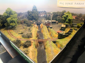 "Photo: 128 The familiar ""party sized Pizza"" layout Pig Dyke Farm, built by SWOONS member Geoff Broadhurst, is a very good display layout for Rod Allcock to show his selection of superb scratch and superdetailed kitbuilt locos and stock ."