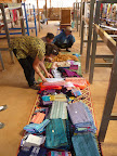 Inspecting the wonderful designs at one of the centres