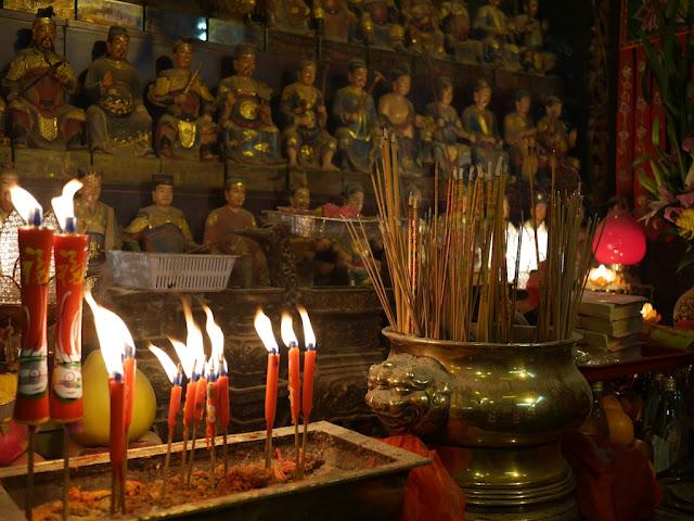 candles burnings in Kwun Yum Temple