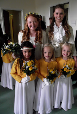2012 The Retiring May Queen, Catherine Wiffen, and Prince, Miriam van Teutem, with some of the retinue in St Mary's Hall