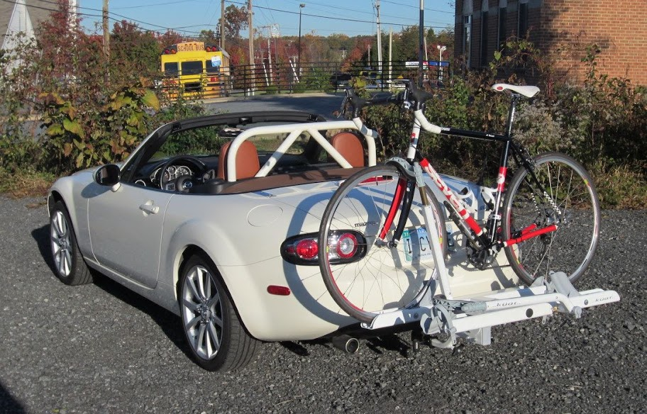 With A Küat Sherpa Tray Style Bike Rack Attached To The Hidden Hitch Receiver Black L Shaped Adapter Is Visible Underneath Per