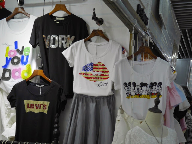 American flag lips shirt and Mickey Mouse shirt for sale at Shiji Tianle in Beijing