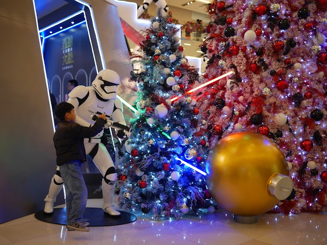 boy touching a Star Wars Stormtrooper's gun at the IAPM shopping center in Shanghai
