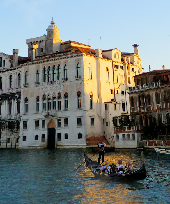 Gondola in Venetian Canal at dusk