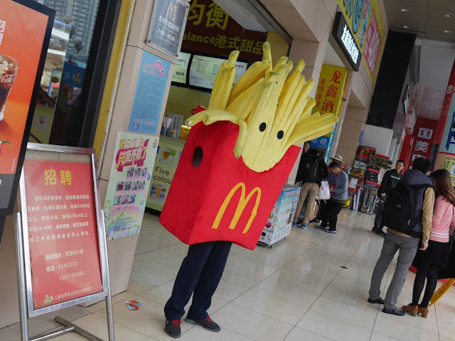 person wearing a McDonald's french fries costume in Shenzhen