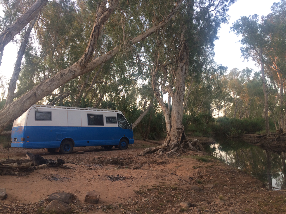 This photo, showing our camp on the Robinson River a while back, shows the drivers front sliding window is rather high.