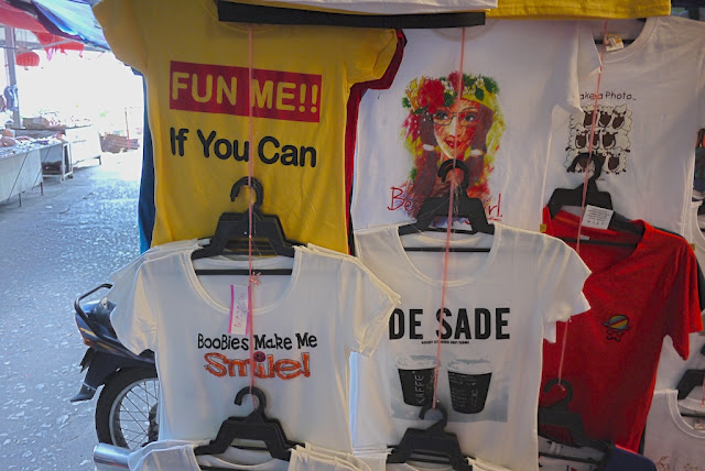 "shirts saying ""Fun Me!! If You Can"" and ""Boobies Make Me Smile!"""