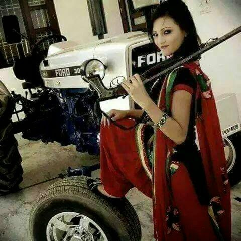 Punjabi Beautiful Girl poses with gun