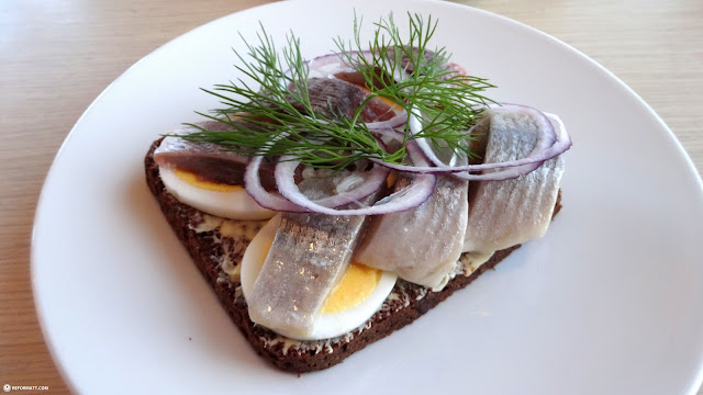 a traditional Icelandic lunch: Herring with Egg on Rye in Reykjavik, Hofuoborgarsvaeoi, Iceland