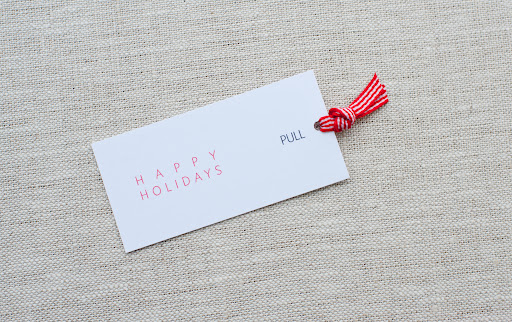 "Download the free""PULL"" tag printable. Cut out the tag with scissors or X-acto knife. Using a 1/8"" hole punch make a hole near the edge of the tag. Cut a piece of ribbon, put it through the hole and knot it."