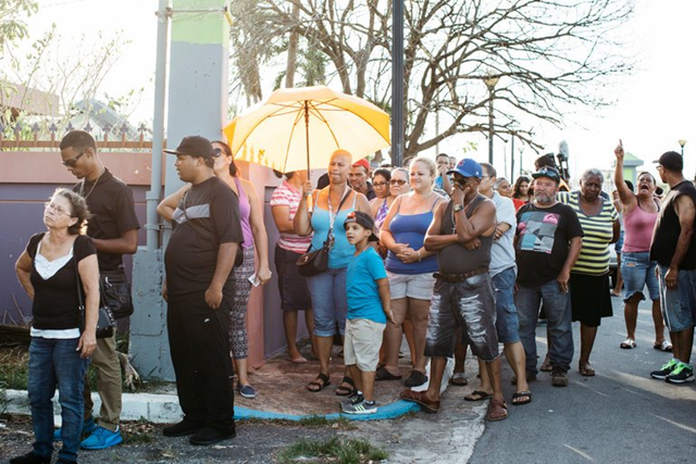 Residents of San Isidro, P.R., wait for food and water in October 2017. Photo: The New York Times