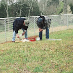 Owen and George replacing a funeral home marker that was broken