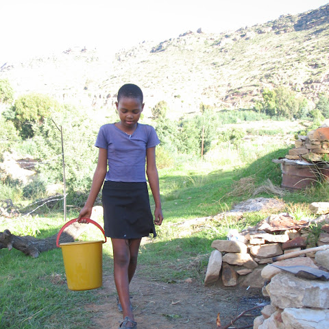 Before school there are all sorts of jobs to do, like fetching water from the local well.