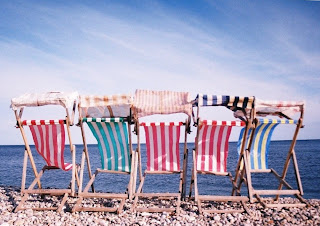 Deck chairs in the wind at Beer
