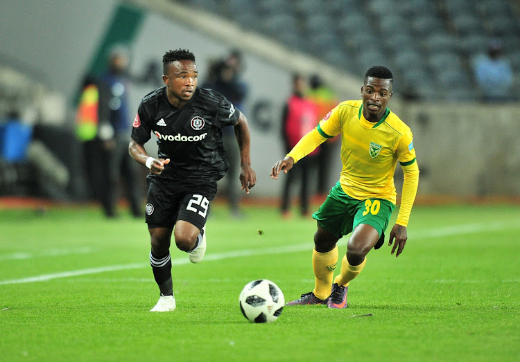 Paseka Mako of Orlando Pirates challenged by Siboniso Conco of Golden Arrows during the Absa Premiership 2018/19 match between Orlando Pirates and Golden Arrows at Orlando Stadium, Johannesburg on 03 October 2018.
