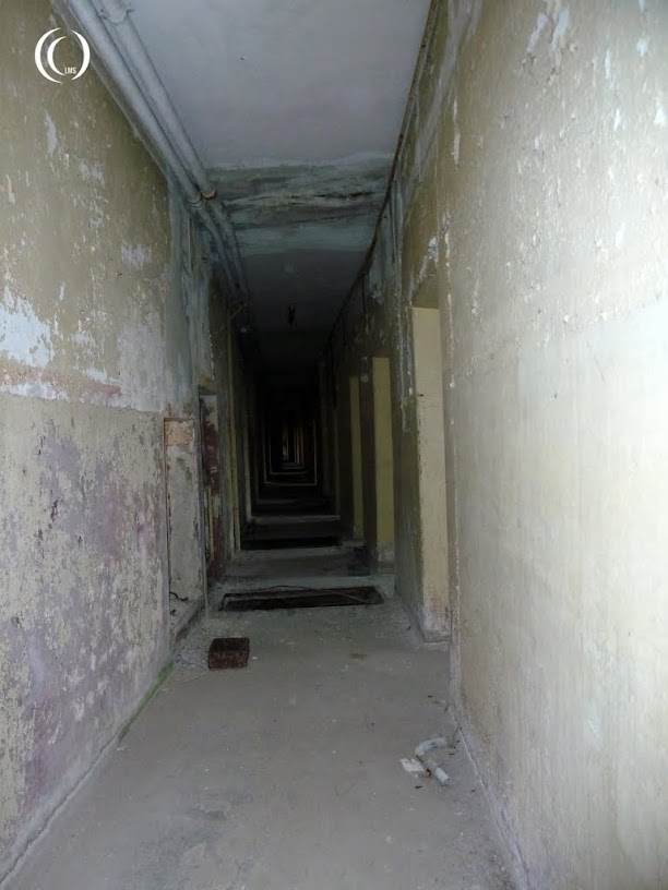 slightly bent hallway between the offices and bomb shelter sections of bunker 005