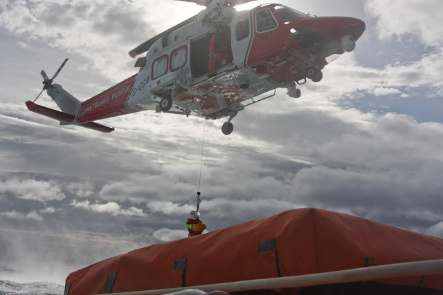 9 October 2011. Poole crew member Dave Leabourne being lowered onto Poole lifeboat. Photo: Poole RNLI/Ade