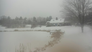 Landscape photo of Cape-style home with snow