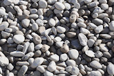 """1 1/2"""" Round - Small, rounded stones each approximately 1 1/2"""" round. Can be used in dry creek beds, dog runs, a decorative landscaping rock, or as a drainage rock."""