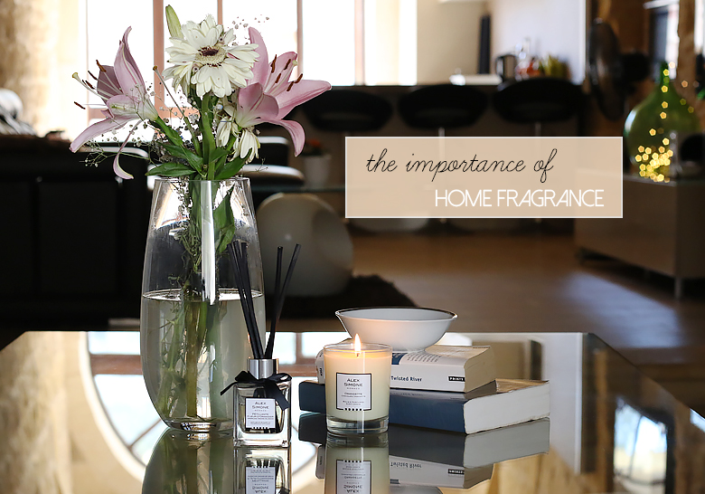 A home fragrance difuser and a scented candle form the brand Alex Simone.