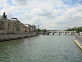 Conciergerie, the Eiffel Tower, and the Louvre on the right in the distance (you can see its roof)