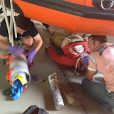 Chris preparing the PS1 Stretcher while Mark maintains a neutral head position on a casualty (Rich) with a severe chest injury - July 2014 Photo: Dave Riley