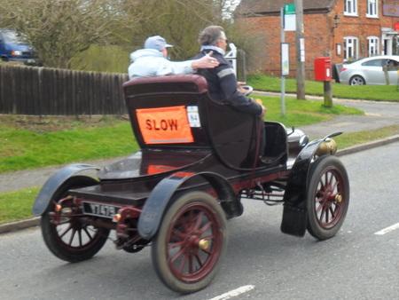 vintage car with SLOW sign on back