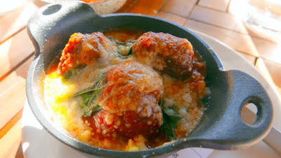 Renata's Italian happy hour, called Aperitivo, is available M-F 4-5:30 in the bar and patio only. This is one of the available dishes, Polpettine a dish of lamb and beef meatballs with polenta