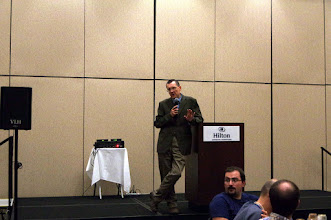 Photo: Mirek speaking at the banquet
